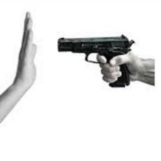 Someone pointing a gun with a side view and someone holding up their hand in front of it