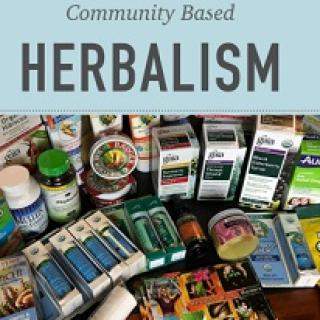 Lots of tinctures and medicinal looking items below and the words Community Based Herbalism above