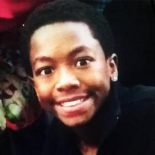 Young black man's face smiling