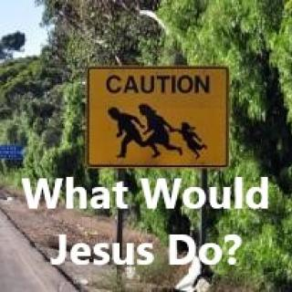 A yellow street sign that shows a family running across a street and the words CAUTION against trees and the words below What Would Jesus Do?
