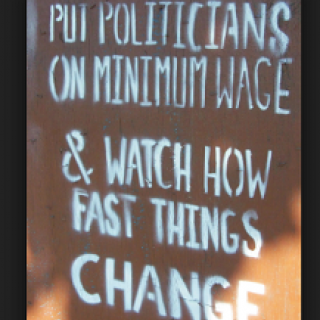 Sign that says Put Politicians on minimum wage and watch how fast things change