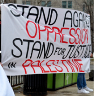 Banner reading Stand Against Oppression Stand for Justice in Palestine