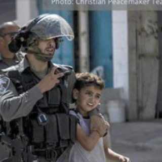 Heavily armed cop grabbing a very young child