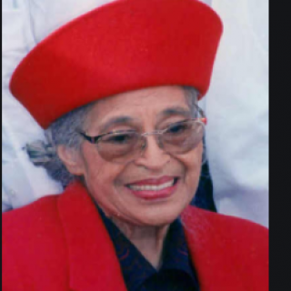 Older woman in red hat