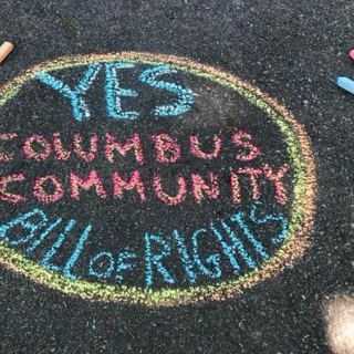 Chalk words on ground Yes Columbus Community Bill of Rights