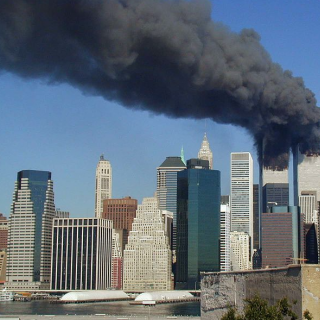 Plumes of smoke billow from the eWorld Trade Center towers in New York City after a Boeing 757 hits each tower during the September 11 attacks