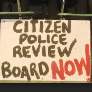 Sign saying Citizen Police Review Board Now
