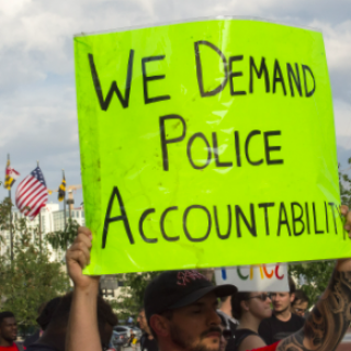 Sign saying We Demand Police Accountability