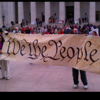 Sign saying We The People