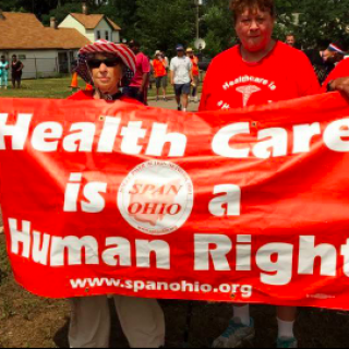 People holding banner saying Health Care is a Human Right