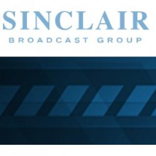 Blue design with sideways rectangles at the bottom and words Sinclair broadcast group at the top