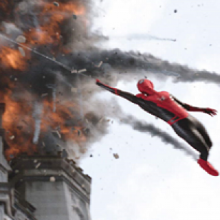 Spiderman in red and blue leotard hanging from a thread swinging out from a burning building