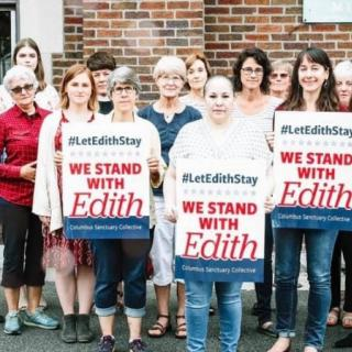 People holding signs saying We Stand with Edith