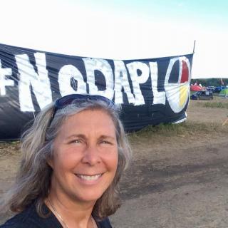 Heidi Detty in front of No DAPL banner