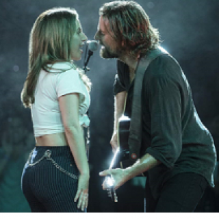 Side view of man and woman singing to each other into a mic, man is playing  guitar