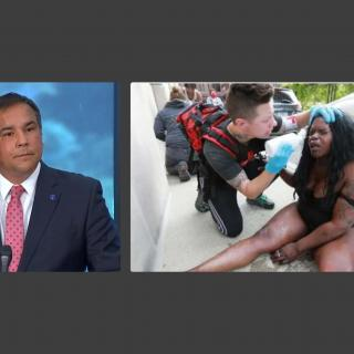 Mayor Ginther and photo of protester