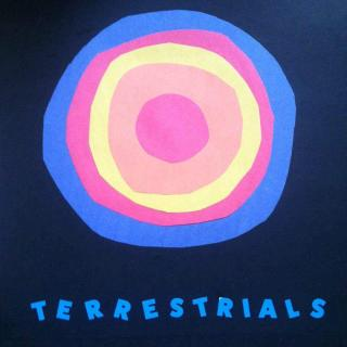 Concentric circles of blue, red, yellow and orange like a sun in the middle of a darker blue background and the word Terrestrials
