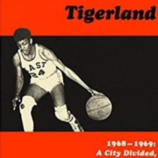 Top part of book cover with a guy playing basketball and the word Tigerland