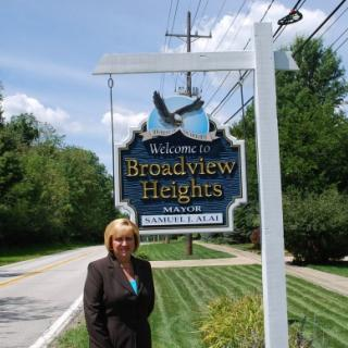 Blonde woman next to the Broadview Hts sign