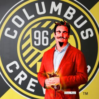 A Circle with the words Columbus Crew in it and the number 96 with cartoonish man wearing a red suite jacket in front with black hair and devil horns, mustache and goatee