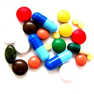 A pile of colorful and different sized pills