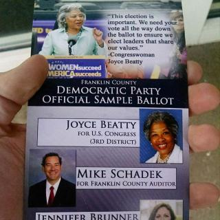 Flier with faces  of men and women running for office with words Democratic Party sample ballot