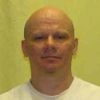 Head shot of white man in white shirt with bald head