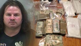 Mug shot of disheveled white guy with long hair next to money and drugs