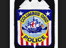 Red white and blue police badge with eagle at top and Santa Maria in the middle with words Columbus Ohio police