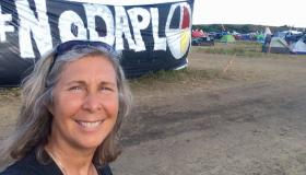 Heidi Detty in front of No DAPL banner